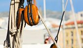 image of pulley  - a wooden pulley equipping an old sailboat - JPG