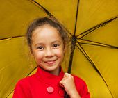 closeup portrait cute girl holding yellow umbrella