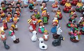 Miniature figures of Bolivian people and lamas