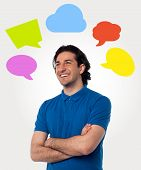 image of thinkers pose  - Smiling thoughtful man with colorful speech bubbles - JPG