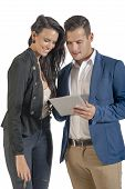 Two young attractive business people working with digital tablet
