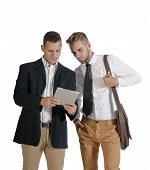 Two handsome business men working with digital tablet
