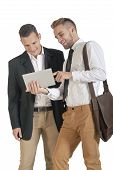 two young attractive business men working with tablet