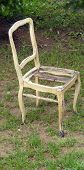 vintage damaged chair on a grass