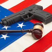 Wooden Judge Gavel And Gun Over Usa Flag - Studio Shoot