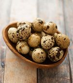 stock photo of quail egg  - healthy fresh organic raw quail eggs on a background - JPG