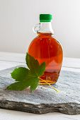 Maple Syrup In A Bottle With Maple Leaf