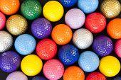 image of miniature golf  - Assortment of colorful mini golf balls on black - JPG