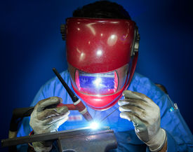pic of tig  - TIG Welding work with worker by hand - JPG