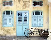 stock photo of rickshaw  - Rickshaw on the background of a traditional house - JPG