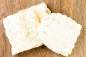 pic of knitted cap  - knitting cap and scarf on wooden background - JPG
