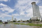 View to the Bangkok city buildings from the Chao Phraya River in Bangkok, Thailand.