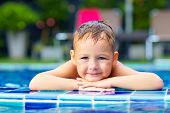 Portrait Of Cute Boy Kid In Pool
