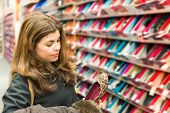 picture of department store  - Middle age real life woman buying shoes in a shoe store - JPG
