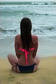 sexy young girl, meditating in front of the sea