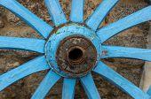 stock photo of wagon wheel  - Turquoise wooden wheel of an old wagon - JPG