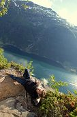 Man In The Mountains Overlooking The Fjord