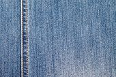 foto of denim wear  - Background of denim with a wide outer seam - JPG