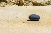 Grey Stone In The Sand On The Beach