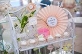 stock photo of sugarpaste  - Birthday party table setting with food and Cake - JPG