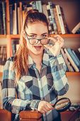 Hipster Girl Holding Magnifying Glass