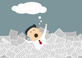 Businessman drowning in a sea of paperwork