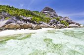 foto of coral reefs  - Turquoise water and coral reef at Anse Source D - JPG