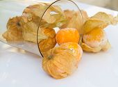Close Up Of Cape Gooseberry Or Physalis Fruit On White Table Background