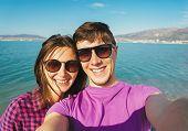 Happy Couple In Love Taking Self-portrait On Beach