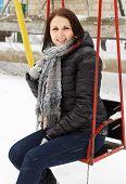 Girl Shakes On Nursery Swing
