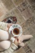 Cup Of Tea In Woman Hands, Top View