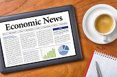 A tablet on a desk - Economic News