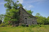 stock photo of yesteryear  - old gray wooden cabin with chimney of yesteryear - JPG