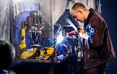 pic of welding  - Mechanical carefully welding the tube by  electric arc - JPG