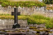 stock photo of graveyard  - Graveyard with stone cross at an old monastery ruin in Gudhem in Sweden.
