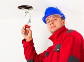 Handsome Electrician Working
