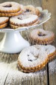 Linzer Cookies Sprinkled With Powdered Sugar