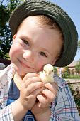 A boy holding a chick