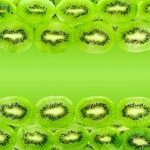 Kiwi Fruit Slices Isolated On A Gradient Green
