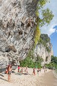 Rock Climbers And Tourists On Railay Beach.