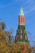 Red Tower Of The Moscow Kremlin Under The Tree