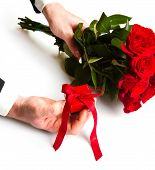 Man's Hand With Red Roses Bouquet And Gift Box