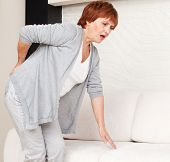 pic of only mature adults  - Adult woman has a backache - JPG