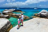 picture of virginity  - Family of mother and kids enjoying view of beautiful scenery of The Baths beach area major tourist attraction at Virgin Gorda - JPG