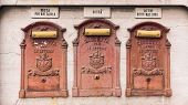 image of mailbox  - three antiques closed mailboxes in the city - JPG