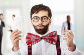 stock photo of suspenders  - Surprised man wearing suspenders with menstruation pad - JPG