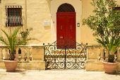 stock photo of olden days  - Traditional exterior door in Malta - JPG