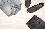 image of no clothes  - many jean clothes and shoes on wood background - JPG