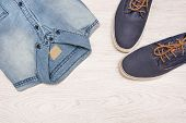 picture of no clothes  - many jean clothes and shoes on wood background - JPG