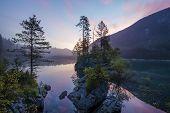 Постер, плакат: Alpine lake Sunrise over the alpine lake Laghi di Fusine